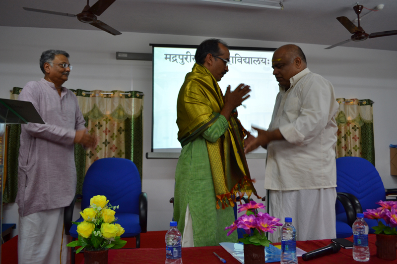 Chief Guest honoured by the principal ; and the Secretary at the Valedictory of the Seminar